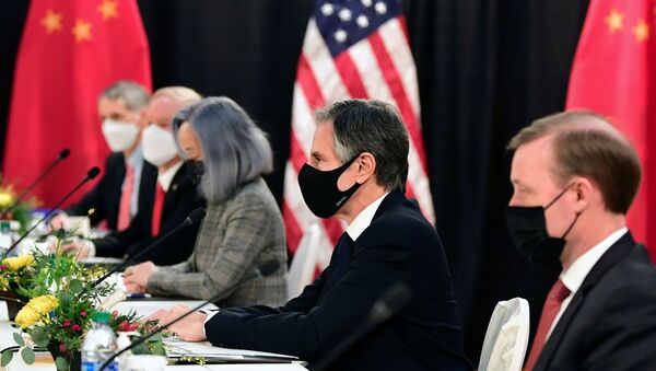 The U.S. delegation led by Secretary of State Antony Blinken (C) and flanked by National Security Advisor Jake Sullivan (R), face their Chinese counterparts at the opening session of U.S.-China talks at the Captain Cook Hotel in Anchorage, Alaska on March 18, 2021. - Sputnik International