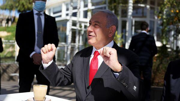 Israel Prime Minister, Benjamin Netanyahu gestures as he sits in a cafe while Israel further eases coronavirus disease (COVID-19) restrictions in Jerusalem March 7, 2021 - Sputnik International