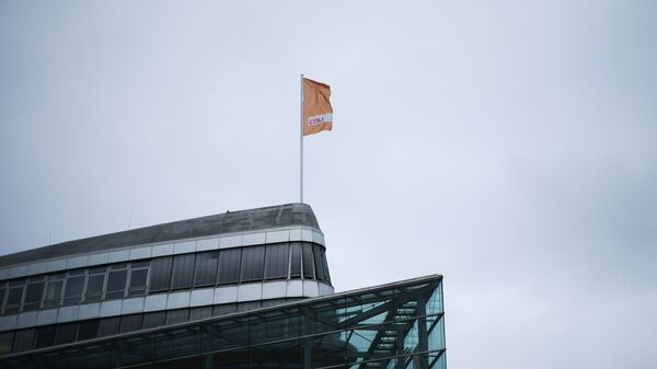 A flag of Germany's Christian Democratic Union party, CDU, the party of Chancellor Angela Merkel, waves in the wind on top of the party's headquarters in Berlin, Germany, March 14, 2021. - Sputnik International