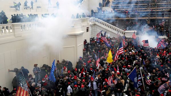 Police release tear gas into a crowd of pro-Trump protesters during clashes at a rally to contest the certification of the 2020 U.S. presidential election results by the U.S. Congress, at the U.S. Capitol Building in Washington, U.S, January 6, 2021. - Sputnik International