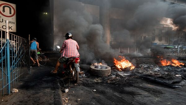 Smoke billows from burning tyres set alight to create smoke cover during a crackdown at Bayint Naung Junction in Yangon, Myanmar March 16, 2021, in this photograph obtained by Reuters. - Sputnik International