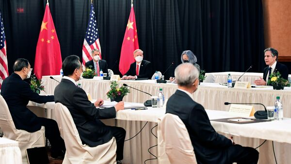 U.S. Secretary of State Antony Blinken (R) speaks while facing Yang Jiechi (L), director of the Central Foreign Affairs Commission Office, and Wang Yi (2nd L), China's State Councilor Wang and Foreign Minister, at the opening session of US-China talks at the Captain Cook Hotel in Anchorage, Alaska on March 18, 2021. - Sputnik International
