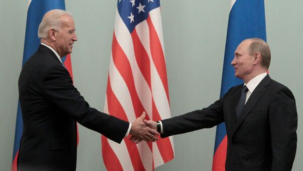 FILE PHOTO: Russian Prime Minister Vladimir Putin (R) shakes hands with U.S. Vice President Joe Biden during their meeting in Moscow March 10, 2011. - Sputnik International