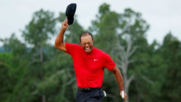Golf - Masters - Augusta National Golf Club - Augusta, Georgia, 14 April 2019 - Tiger Woods of the U.S. celebrates on the 18th hole after winning the 2019 Masters - Sputnik International