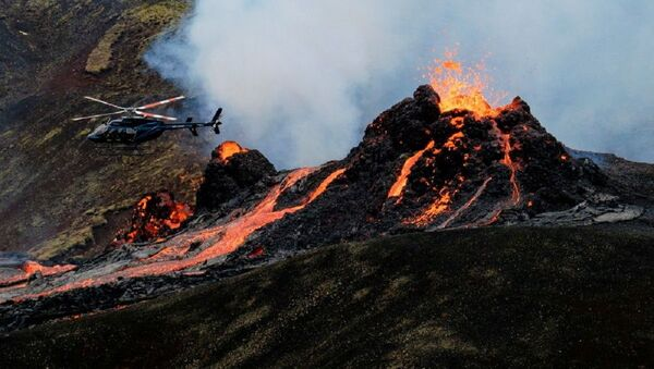 Lava flows from a volcano in Reykjanes Peninsula, Iceland March 20, 2021 in this picture obtained from social media. Picture taken March 20, 2021 - Sputnik International