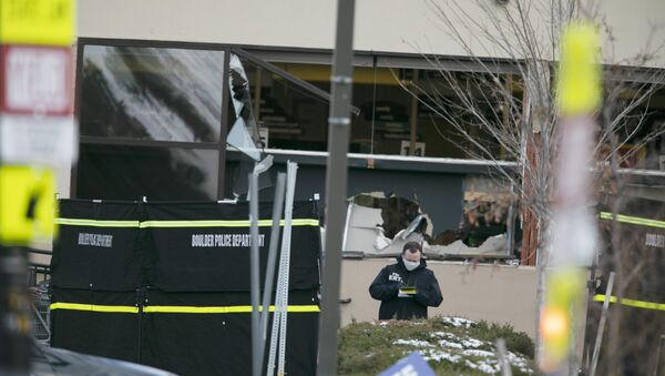 Police work on the scene outside of a King Soopers grocery store where authorities say multiple people were killed in a shooting, Monday, March 22, 2021, in Boulder, Colorado.  - Sputnik International