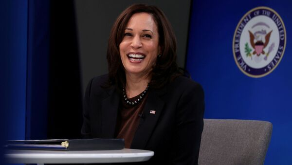 U.S. Vice President Kamala Harris smiles after delivering a keynote address to the House Democratic Caucus virtually on camera from the Eisenhower Executive Office Building at the White House in Washington, U.S. March 2, 2021 - Sputnik International