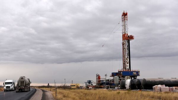 A drilling rig operates in the Permian Basin oil and natural gas production area in Lea County, New Mexico, U.S., February 10, 2019.  - Sputnik International