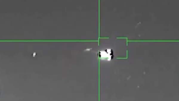 A video purported to be of a Houthi anti-air missile striking a US MQ-9 Reaper drone over Mari'b Governorate on March 23, 2021 - Sputnik International
