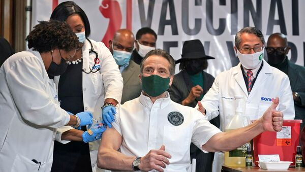 New York Governor Andrew Cuomo is vaccinated at a church in the Harlem neighborhood of New York City amid the coronavirus disease (COVID-19) pandemic, New York, U.S., March 17, 2021 - Sputnik International