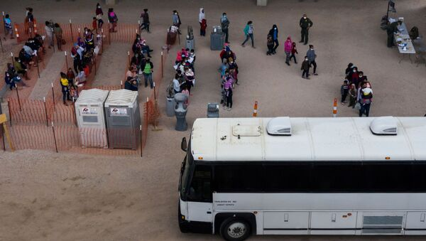 Asylum seeking migrant families from Central America line up to be transported from a make shift U.S. Customs and Border Protection processing center under the Anzalduas International Bridge after crossing the Rio Grande river into the United States from Mexico in Granjeno, Texas, U.S., March 24, 2021 - Sputnik International