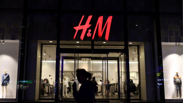 A woman walks past a store of the Swedish fashion retailer H&M at a shopping mall in Beijing, China March 24, 2021 - Sputnik International