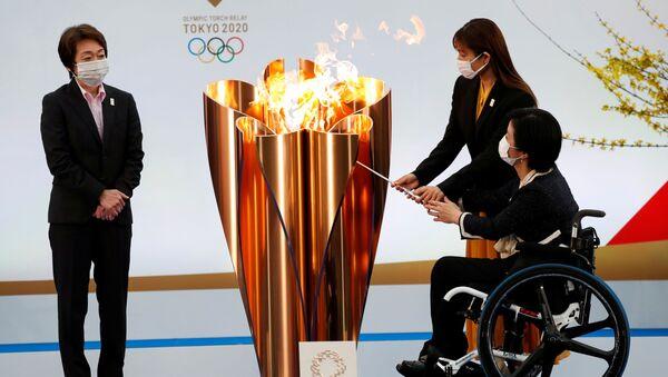 Глава оргкомитета Олимпийских игр 2020 Сэйко Хасимото во время старта эстафеты огня в префектуре Фукусима  - Sputnik International