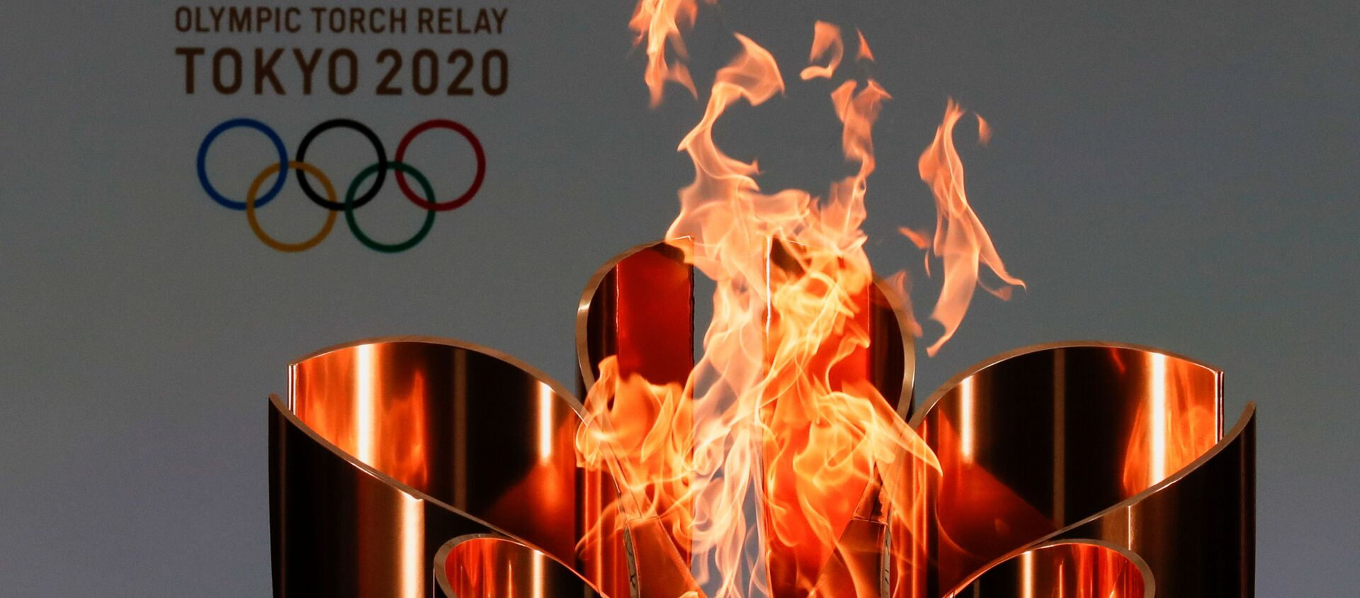 The celebration cauldron is lit on the first day of the Tokyo 2020 Olympic torch relay in Naraha, Fukushima prefecture, Japan March 25, 2021.  - Sputnik International, 1920, 23.07.2021
