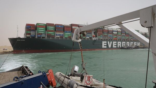 Stranded container ship Ever Given, one of the world's largest container ships, is seen after it ran aground, in Suez Canal, Egypt March 25, 2021 - Sputnik International