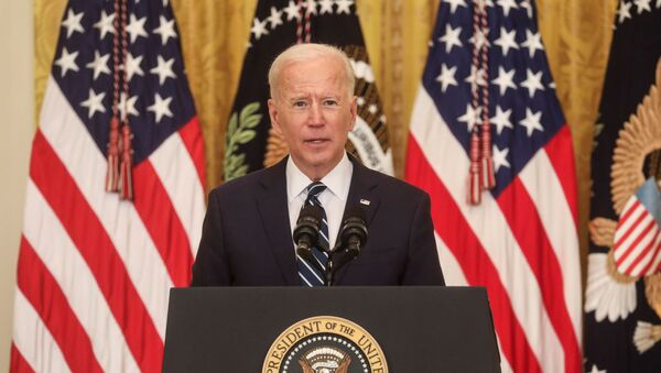U.S. President Joe Biden speaks to reporters as he holds his first formal news conference in the East Room of the White House in Washington, U.S., March 25, 2021. REUTERS/Leah Millis - Sputnik International