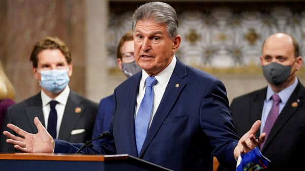 U.S. Senator Joe Manchin (D-WVA) removes his mask to speak as bipartisan members of the Senate and House gather to announce a framework for fresh coronavirus disease (COVID-19) relief legislation at a news conference on Capitol Hill in Washington, U.S., December 1, 2020 - Sputnik International