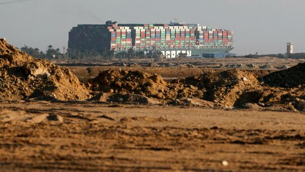 Stranded container ship Ever Given, one of the world's largest container ships, is seen after it ran aground, in Suez Canal, Egypt March 26, 2021 - Sputnik International