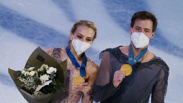 Victoria Sinitsina and Nikita Katsalapov receiving their gold medals after securing world titles in ice dance at World Figure Skating Championships in Stockholm, Sweden - Sputnik International