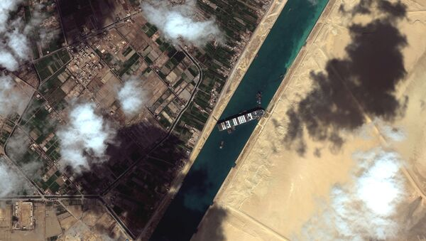 A general view of the Ever Given container ship in Suez Canal, in Suez Canal in this Maxar Technologies satellite image taken on March 27, 2021.  - Sputnik International