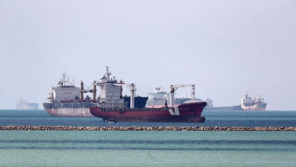 Ships are seen at the entrance of Suez Canal, where stranded container ship Ever Given run aground, Egypt on 28 March 2021.  - Sputnik International