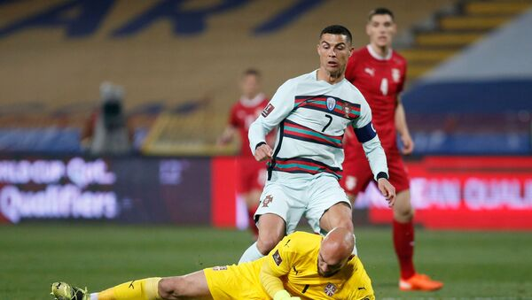 Portugal's Cristiano Ronaldo in action with Serbia's Marko Dmitrovic  - Sputnik International