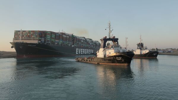 A view shows the container ship Ever Given, one of the world's largest container ships, after it was partially refloated, in Suez Canal, Egypt March 29, 2021 - Sputnik International