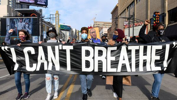 Protesters march through downtown Minneapolis during the I Can't Breathe  Silent March for Justice a day before jury selection is scheduled to begin for the trial of Derek Chauvin, the former Minneapolis policeman accused of killing George Floyd, in Minneapolis, Minnesota, 7 March 2021. - Sputnik International