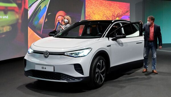 Volkswagen's new electric car ID.4 SUV is pictured during its handover by the German automaker to first customers Jaqueline Heyer-Mertens and her husband Mario Heyer at the Glaeserne Manufaktur in Dresden, Germany, March 26, 2021. - Sputnik International