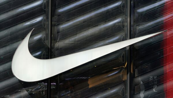 FILE PHOTO: The Nike swoosh logo is seen outside the store on 5th Ave in New York, New York, U.S., March 19, 2019.   - Sputnik International
