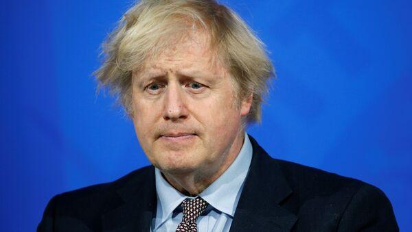 Britain's Prime Minister Boris Johnson holds a news conference on the coronavirus disease (COVID-19) pandemic, in London, Britain March 29, 2021 - Sputnik International