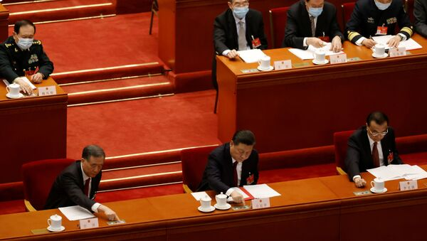 Chinese President Xi Jinping and other leaders cast their votes on Hong Kong electoral reform at the closing session of the National People's Congress (NPC) at the Great Hall of the People in Beijing, China March 11, 2021 - Sputnik International