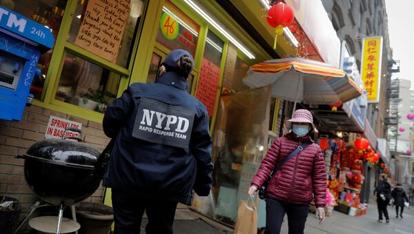 Detective Suk Too, of the New York Police Department (NYPD) Community Affairs Rapid Response Team, checks on businesses in the Chinatown section of Manhattan following the deadly shootings at three spas in Georgia, in New York City, New York, U.S., March 17, 2021 - Sputnik International