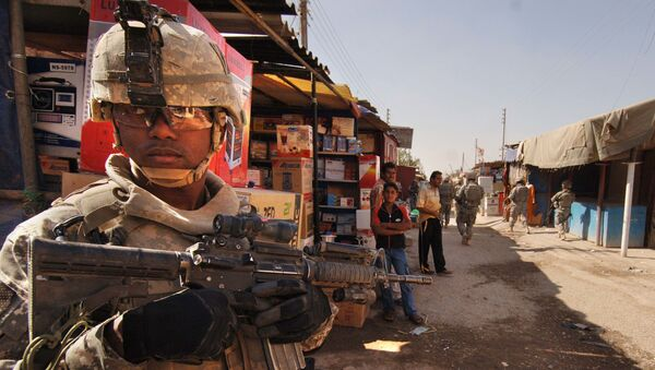 U.S. Army Staff Sgt. Jerrime Bishop provides security during a joint dismounted presence patrol with Iraqi National Police at a market in Narhwan, Iraq, Nov. 1, 2007. - Sputnik International