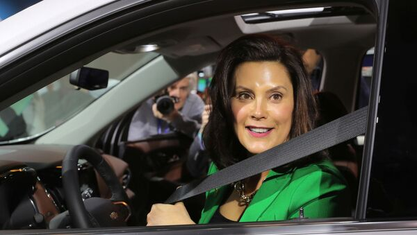 Michigan Governor Gretchen Whitmer sits in a 2019 Chevrolet Traverse, assembled in Lansing, Michigan, at the General Motors display area during the North American International Auto Show in Detroit, Michigan, U.S., January 15, 2019. - Sputnik International