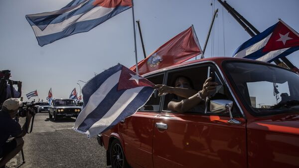 Soviet-era Lada cars flying Cuban flag drive past the American embassy during a rally calling for the end of the US blockade against the island nation in Havana, Cuba, Sunday, March 28, 2021 - Sputnik International