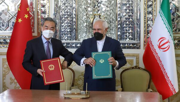 Iran's Foreign Minister Mohammad Javad Zarif and China's Foreign Minister Wang Yi bump elbows during the signing ceremony of a 25-year cooperation agreement, in Tehran, Iran March 27, 2021 - Sputnik International