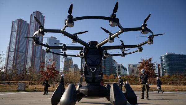 A HEXA all-electric Vertical Takeoff and Landing (eVTOL) single-passenger multicopter ultralight aircraft, produced by US company LIFT Aircraft, is displayed at an event showcasing a 'Drone Traffic Management System' by the Ministry of Land Infrastructure and Transport, at Yeouido island in Seoul on November 11, 2020. - Sputnik International