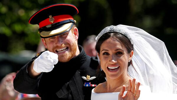Britain's Prince Harry gestures next to his wife Meghan as they ride a horse-drawn carriage after their wedding ceremony at St George's Chapel in Windsor Castle in Windsor, Britain, May 19, 2018. - Sputnik International