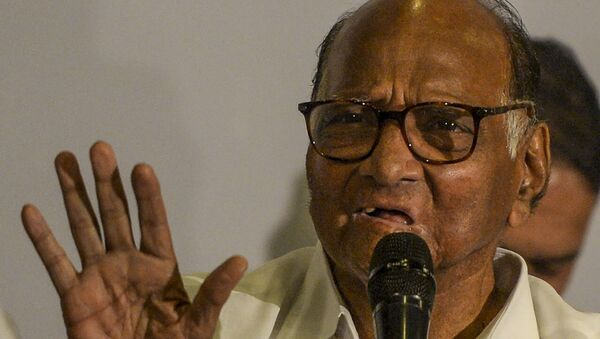 National Congress party president Sharad Pawar gestures as he speaks during a press conference in Mumbai on November 12, 2019.  - Sputnik International