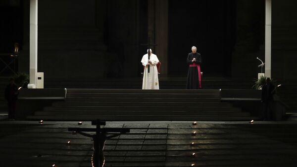 Pope Francis presides over the Via Crucis – or Way of the Cross – ceremony in St Peter's Square devoid of tourists and the faithful, who would normally be flocking to the spot, because of Italy's ban on gatherings to prevent the spread of coronavirus, at the Vatican, Friday, 10 April 2020. - Sputnik International