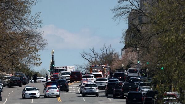 Emergency vehicles on scene after a vehicle charged a barricade at the U.S. Capitol on April 02, 2021 in Washington, DC. The U.S. Capitol was locked down after a person reportedly rammed a vehicle into two Capitol Hill police officers. A suspect was apprehended.  - Sputnik International