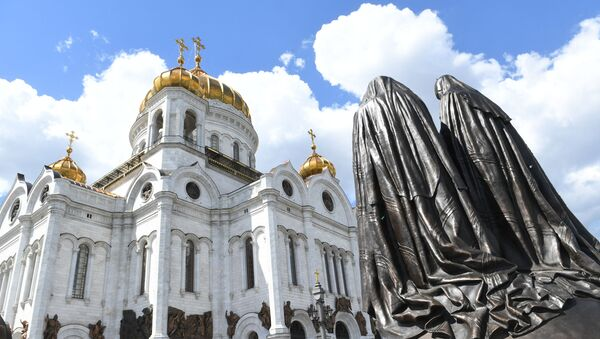 Monument Reunion was opened at the Cathedral of Christ the Savior. The sculptural composition is dedicated to a historical event - the reunification of the Russian Orthodox Church (ROC) and the Russian Orthodox Church Abroad (ROCOR), which took place in the Cathedral of Christ the Savior on May 17, 2007. - Sputnik International