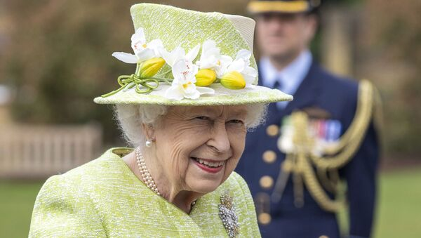 Britain's Queen Elizabeth II during a visit to the CWGC, the Commonwealth War Graves Commission Air Forces Memorial to attend a service to mark the Centenary of the Royal Australian Air Force, in Runnymede, England, Wednesday March 31, 2021.  - Sputnik International