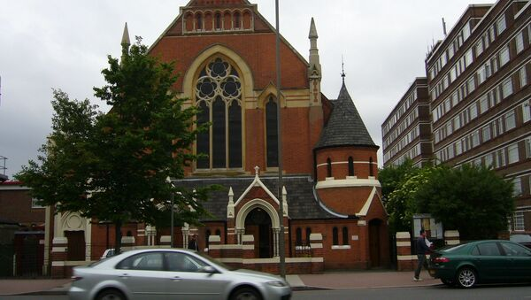 The Polish Roman Catholic Church of Christ the King in Balham High Road, Balham, London. Part of Du Cane Court can be seen on the right. - Sputnik International