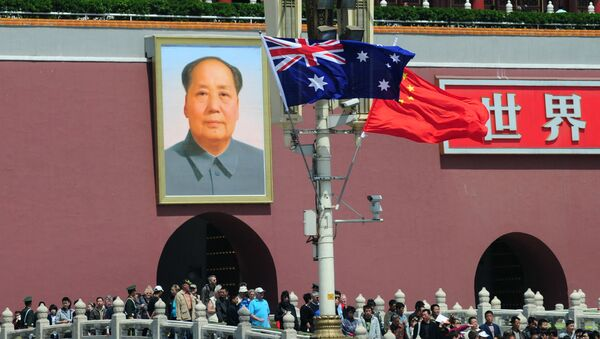 The national flags of Australia and China are displayed before a portrait of Mao Zedong facing Tiananmen Square, during a visit by Australia's Prime Minister Julia Gillard in Beijing on April 26, 2011.  AFP PHOTO/Frederic J. BROWN (Photo by FREDERIC J. BROWN / AFP) - Sputnik International