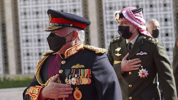 In this photo released by the Royal Hashemite Court, Jordan's King Abdullah II arrives for the inauguration of the 19th Parliament's non-ordinary session to  deliver a speech from the throne, in Amman Jordan, Thursday, Dec. 10, 2020.  - Sputnik International