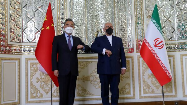 Iran's Foreign Minister Mohammad Javad Zarif and China's Foreign Minister Wang Yi bump elbows during the signing ceremony of a 25-year cooperation agreement, in Tehran, Iran March 27, 2021. - Sputnik International