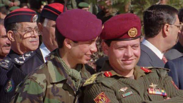 Jordan's Prince Hamza, 19, left, whispers in the ears of his elder brother, Prince Abdullah, 37, in this June 1998 photo taken during a military parade in Jordan.  - Sputnik International