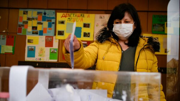A woman casts her vote at a polling station during the country's parliamentary election in Sofia on April 4, 2021.  - Sputnik International